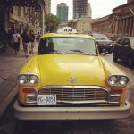 Cool vintage taxi parked outside of The Fairmont Royal York during the conference.